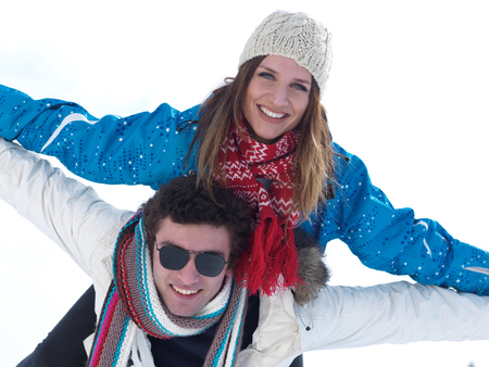 couple outdoor: portrait of happy young romantic tourist  couple outdoor in nature at winter vacation Stock Photo