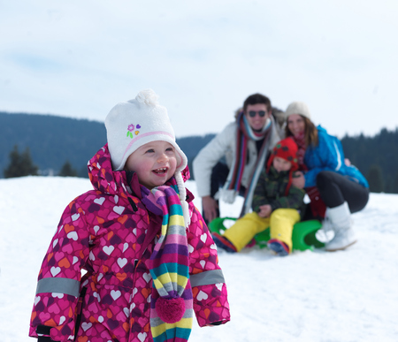 cold season: Winter playing, fun, snow and family portrait  sledding at winter time