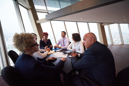 developers: startup business people group have meeting in modern bright office interior, senoir investors  and young software  developers Stock Photo