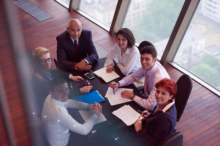 office meeting: startup business people group have meeting in modern bright office interior, senoir investors  and young software  developers Stock Photo