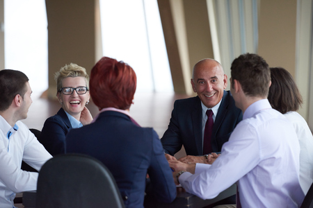corporate training: startup business people group have meeting in modern bright office interior, senoir investors  and young software  developers Stock Photo