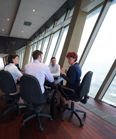 woman business suit: startup business people group have meeting in modern bright office interior, senoir investors  and young software  developers Stock Photo
