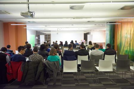 speaker on education conference presentation at modern startup interior