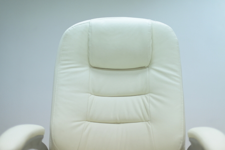 executive chair: modern white office chair furiniture in empty startup business space Stock Photo
