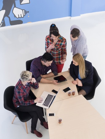 group of business people: top view of multi ethnic startup business people group on brainstorming meeting in modern bright office interior Stock Photo