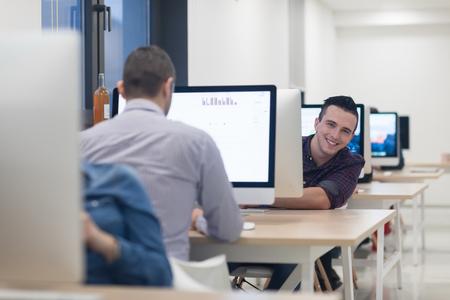 modern office: startup business, software developer working on desktop  computer at modern office