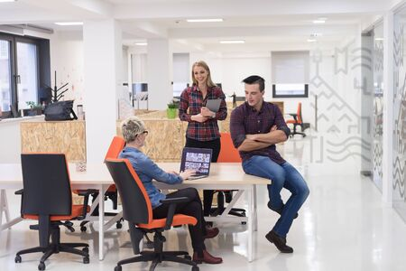 office meeting: portrait of creative business people group in modern startup office interior Stock Photo