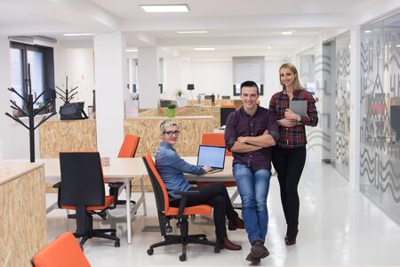 small group: portrait of creative business people group in modern startup office interior Stock Photo