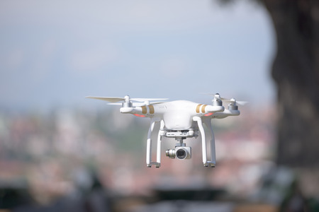 drones: aerial photography,  quadcopter  drone flying over the city. New digital photo and video technology Stock Photo