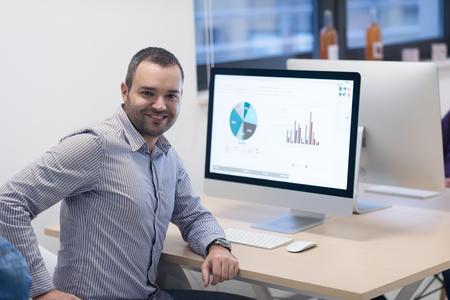 telephone salesman: startup business, software developer working on desktop  computer at modern office