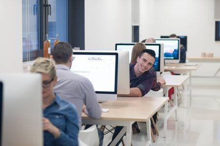 happy workers: startup business, software developer working on desktop  computer at modern office