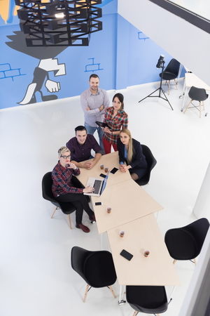 business conference: top view of multi ethnic startup business people group on brainstorming meeting in modern bright office interior Stock Photo