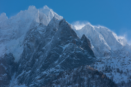 French alps mountain peaks covered with fresh snow. Winter landscape nature scene on beautiful sunny winter day.