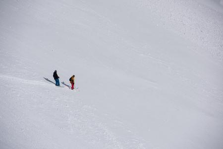 deep powder snow: extreme freeride skier skiing on fresh powder snow in downhill at winter mountains