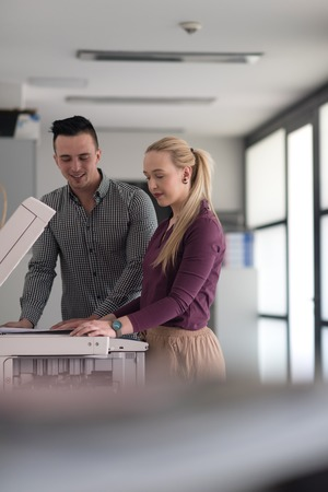 copy machine: happy business people group at modern office copy  documents on machine