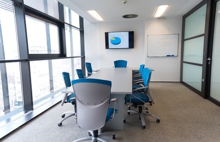 interior of new modern office meeting room with big windows