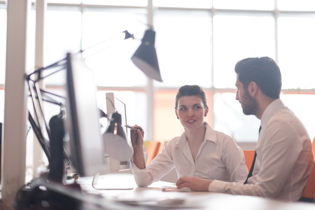 modern office: business couple working together on project at modern startup office Stock Photo
