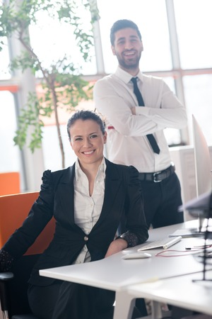 busy beard: startup business couple portrait at modern bright office interior Stock Photo
