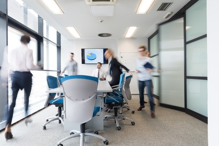 the entering: startup business, young creative  people group entering meeting room,  modern office interior and motion blur
