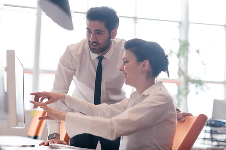 business couple working together on project at modern startup office Stock Photo