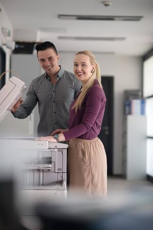 photocopier: happy business people group at modern office copy  documents on machine