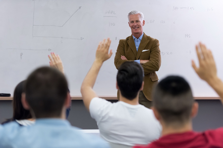 study group: group of students study with professor in modern school classroom