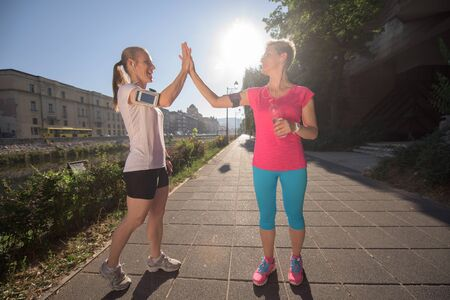 congratulate: jogging friends couple congratulate and happy to finish their morning workout