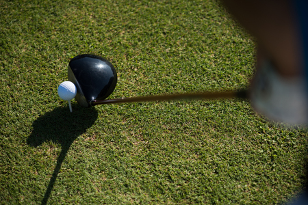 point of view: top view of golf club and ball in grass on course preparing for shot Stock Photo