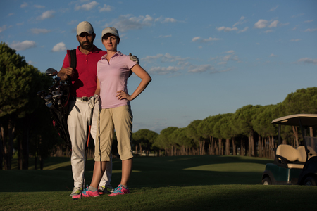 happy seniors: portrait of happy young  couple on golf course