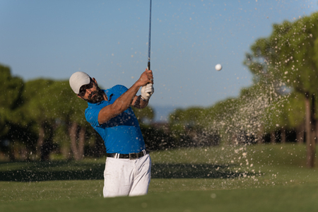 pro golf player shot ball from sand bunker at course Stock Photo