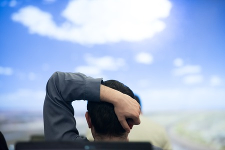 abstract academic: happy  man as audience sitting and relaxing on presentation while looking on beaudiful sky with cloud  and dreaming Stock Photo