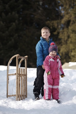Brother and sister portrait in winter time Stock Photo