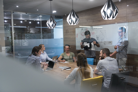company: startup business team brainstorming on meeting   working on laptop and tablet computer