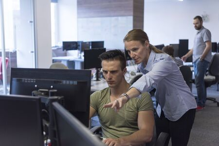 people together: business couple working together on project at modern startup office Stock Photo