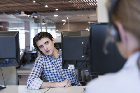 businessman in office: young business people at modern office workplace  getting social in free time