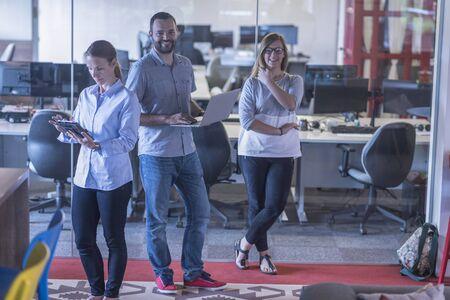 business team: start up business team portrait at modern office interior