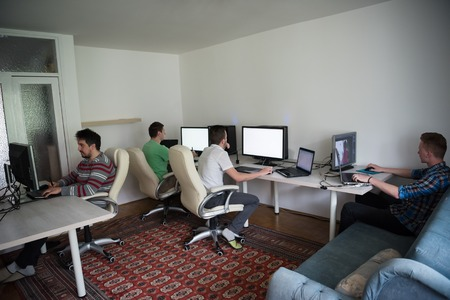 testing vision: a group of young graphic designers working on a digital tablet and a computer Stock Photo