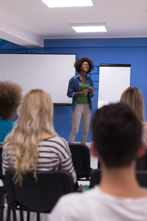team leadership: Young african american Speaker Seminar Corporate Business Meeting Concept Stock Photo