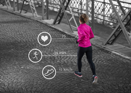 woman running: Woman running across the bridge with statistics in background Stock Photo