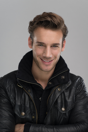 young male: Fashion man, Handsome serious beauty male model portrait wear leather jacket, young guy over gray background