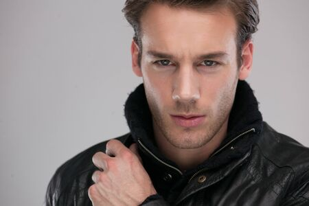 serious guy: Fashion man, Handsome serious beauty male model portrait wear leather jacket, young guy over gray background