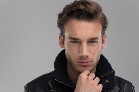 young guy: Fashion man, Handsome serious beauty male model portrait wear leather jacket, young guy over gray background
