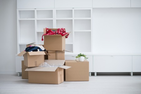 Moving boxes in empty room Stock Photo
