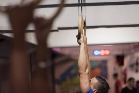 cropped shots: Cropped shot of male hands on gymnastics rings