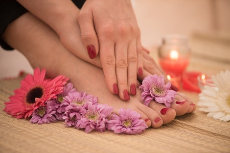 Closeup photo of a female feet and hands at spa salon on pedicure and manicure procedure Banco de Imagens - 73615938