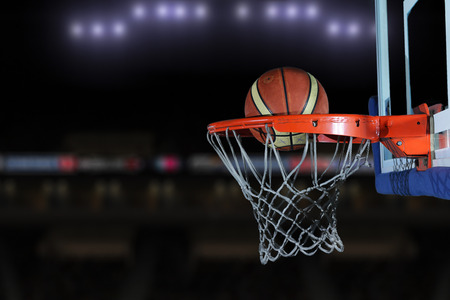 Basketball ball,  board and net  on grey  background in gym indoor Stock Photo