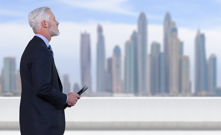 impersonal: Portrait of senior businessman in front of the big city Stock Photo