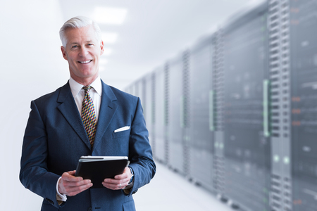 Portrait of senior businessman in big rack server room Banco de Imagens
