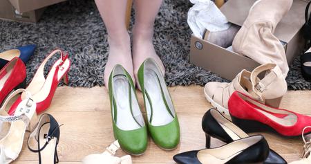 opentoe: Woman Chooses  Shoes At Fashionable Shop Stock Photo