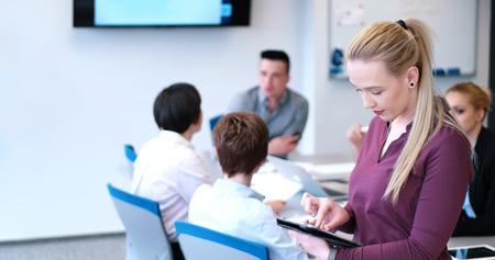 Business Woman Using Digital Tablet in Busy Office Reklamní fotografie